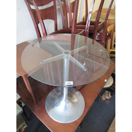 2420 - Circular glass pedestal occasional table with spun cast aluminium column support and circular foot, ...
