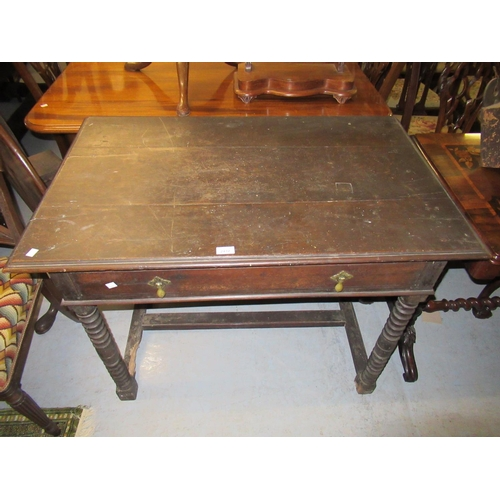 2432 - 18th Century oak side table, the moulded top above a single drawer with brass drop handles on bobbin...