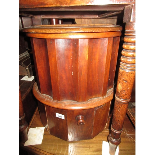 2436 - 19th Century mahogany circular commode with leather inset top (at fault)...