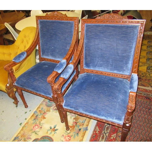 2441 - Pair of reproduction mahogany open armchairs having blue dralon upholstry and carved decoration in E...