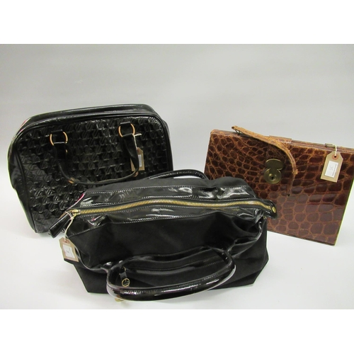 35 - Two Jaeger ladies black patent leather handbags, together with a leather simulated crocodile handbag...