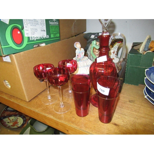 780 - Four cranberry glass beakers, similar jug decanter and three hock style wine glasses...
