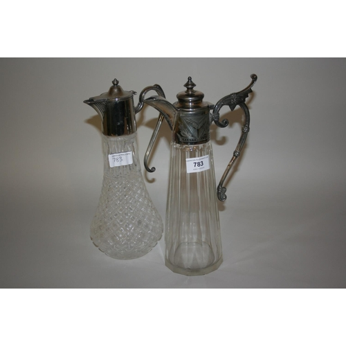 783 - Late 19th or early 20th Century faceted glass claret jug with plated mounts, together with a similar...