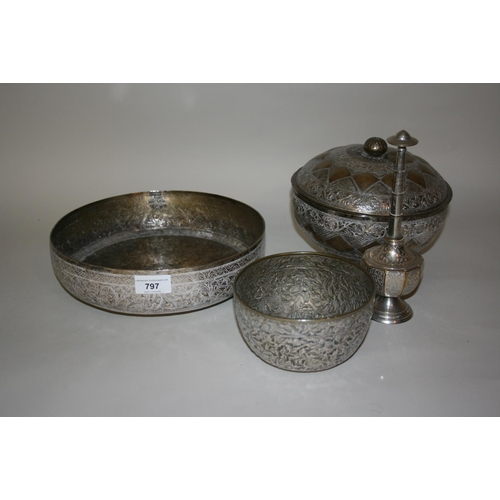 797 - Burmese white metal shallow fruit bowl, together with two other metal bowls, one with cover and a ro...