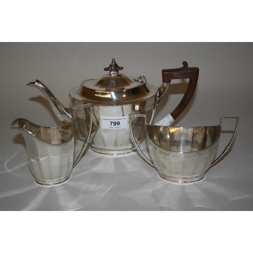 799 - Mappin and Webb Sheffield silver three piece tea service of oval faceted design...
