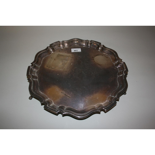 801 - Edwardian silver salver in 18th Century style, the shaped moulded rim enclosing a plain centre panel...