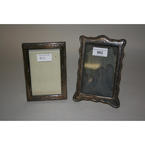 803 - Small Birmingham silver photograph frame with shaped edge together with a similar small plain rectan...