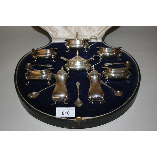810 - Cased Birmingham silver eight piece condiment set with original blue glass liners and six spoons...