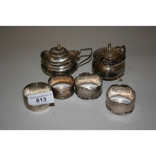 813 - Two silver mustards and four various silver napkin rings...