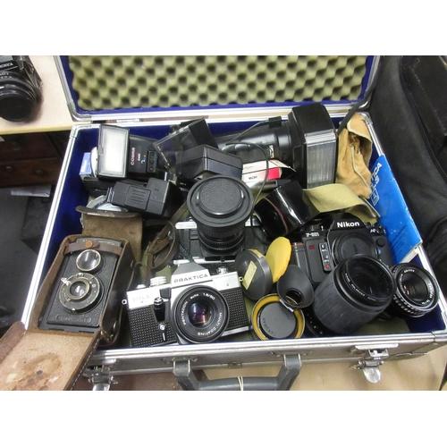99 - Nikon F-501 camera , Voigtlander camera, Minolta camera, Praktica camera together with various acces...