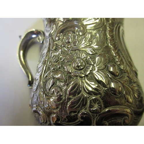798 - George II silver baluster form mug with scroll handle and later chased decoration, London 1752...