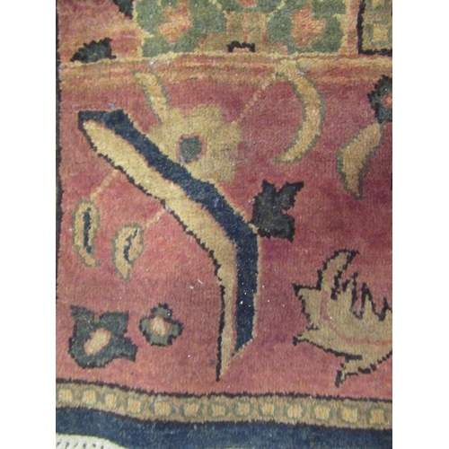 13 - Agra carpet of all-over floral design on burgundy ground with multiple borders, 119ins x 167ins...