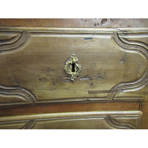 1893 - 18th Century French provincial oak commode, the moulded top above two short and two long drawers wit...