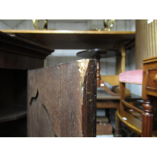2403 - Small George III oak hanging cabinet with single arch door enclosing shaped shelves...