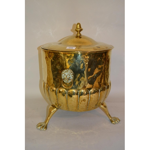 1036 - 19th Century brass coal purdonium with lid, lion mask side handles and paw supports...