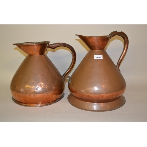 1050 - Two large antique copper measures, a copper two handled preserve pan and two copper coal scuttles wi...