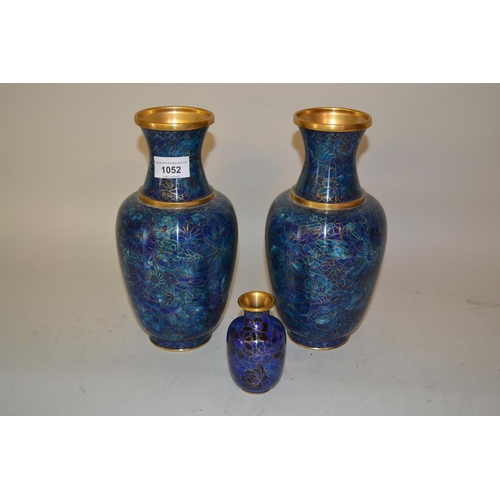 1052 - Pair of 20th Century cloisonne baluster form vases decorated with flowers on a mottled blue ground, ...