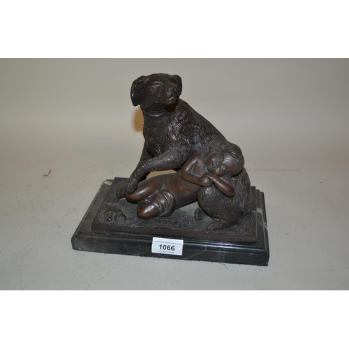 1066 - Late 20th Century dark patinated bronze group of a child with a dog on a rectangular marble plinth, ...