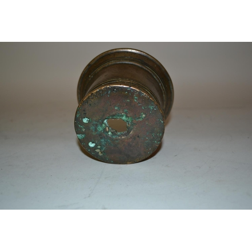 1071 - Antique bronze mortar of plain turned design (holed to the base), 8.5cms high, 12cms diameter...