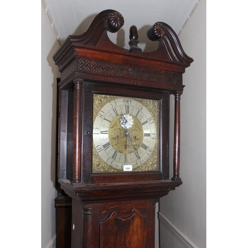 1089 - 19th Century oak longcase clock, the broken arch hood above a square brass engraved dial with silver...