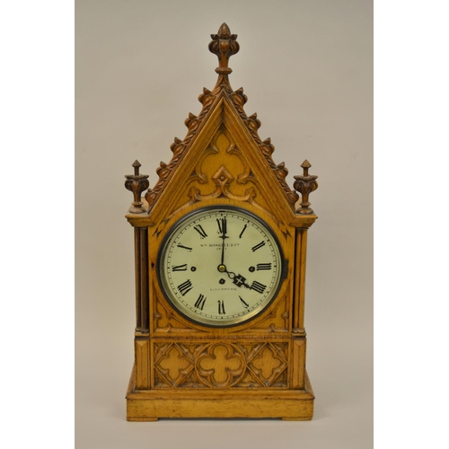 1091 - Victorian pale oak bracket clock of Gothic Revival design, the painted dial with Roman numerals, sig...