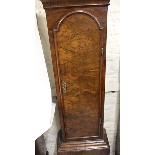 1093 - Figured walnut longcase clock, the broken arch hood with flanking pilasters above a moulded panel do...