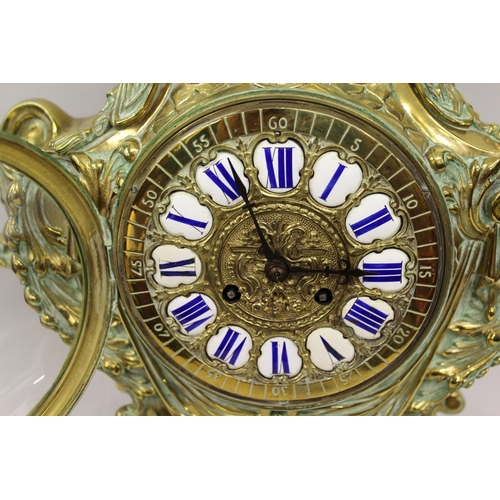 1094 - Large 19th Century French gilt brass mantel clock of rococo design, the shaped case with an urn surm...