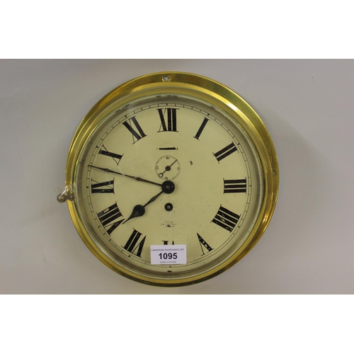 1095 - Ships brass bulkhead clock, the painted dial with Roman numerals inscribed ' Examined by J.B. Yabsle...