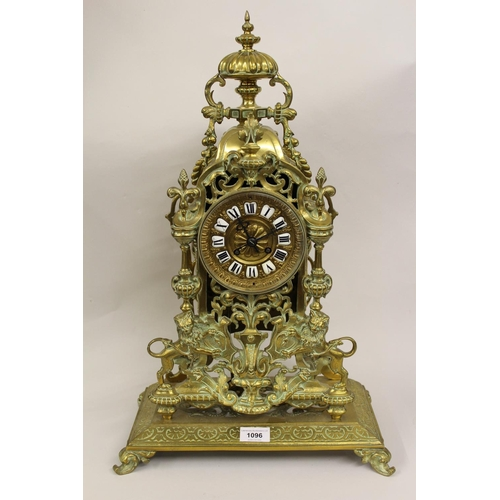 1096 - Large 19th Century gilt brass mantel clock with urn surmount, the case of open work design and decor...