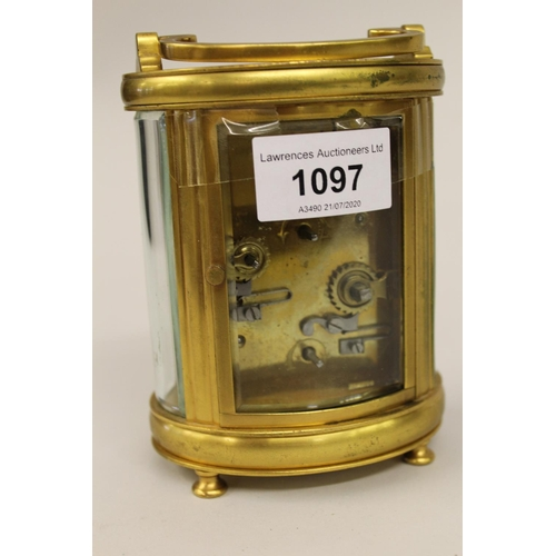 1097 - Late 19th or early 20th Century French gilt brass cased carriage clock, the white enamel dial signed...