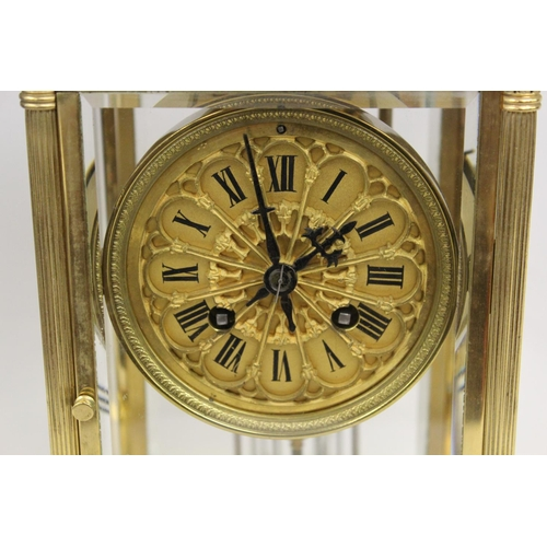 1100 - Late 19th or early 20th Century French gilt brass four glass library clock, the pierced Gothic dial ...