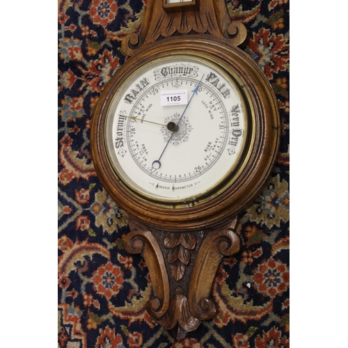1105 - Late 19th or early 20th Century carved oak aneroid barometer / thermometer with enamel dials...