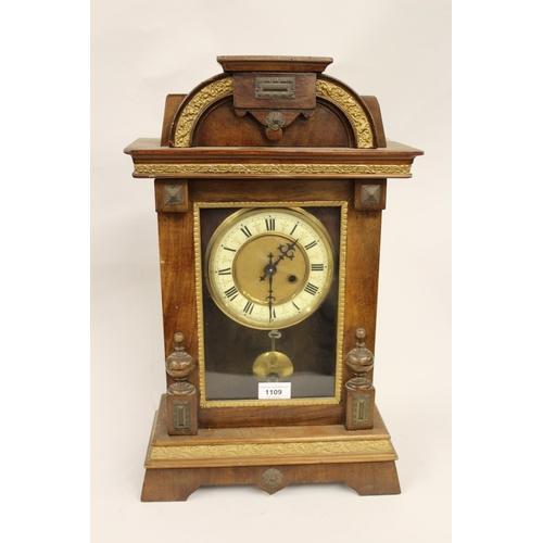 1109 - Late 19th Century German walnut cased mantel clock with a single train movement...