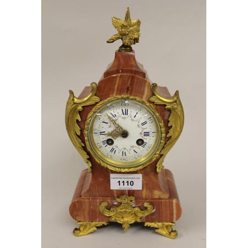 1110 - 19th Century French rouge marble and ormolu mounted mantel clock, the enamel dial with Roman numeral...