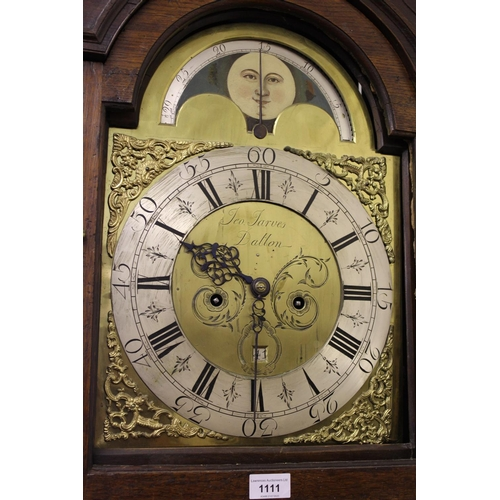1111 - Victorian oak and mahogany crossbanded longcase clock, the broken arch hood above an arched panelled...