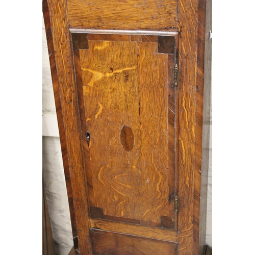 1112 - George III oak and mahogany crossbanded longcase clock, the square hood with a painted dial and Roma...