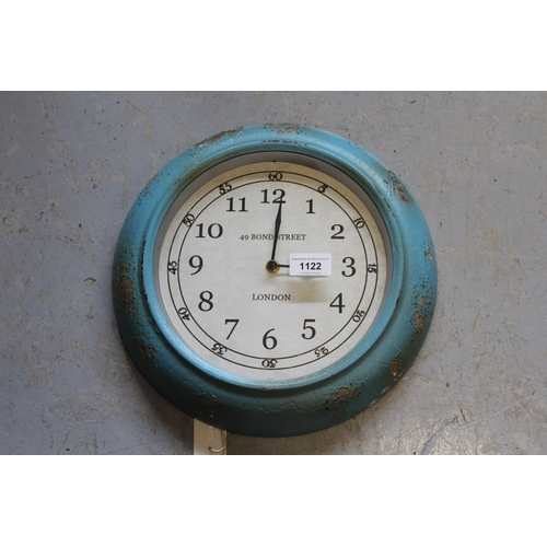 1122 - Reproduction Blooming Ville circular distressed blue painted wall clock with quartz movement...