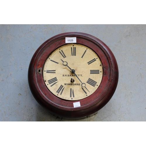 1123 - Circular mahogany wall clock, the paper dial with Roman numerals, inscribed Barrett, Wimborne, with ...