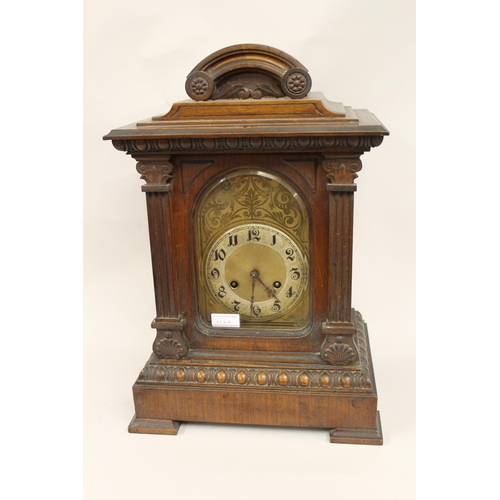 1125 - Late Victorian walnut bracket clock, the arched dial with Arabic numerals with a two train movement ...
