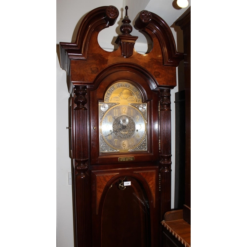 1129 - Large reproduction mahogany and figured walnut longcase clock, the broken arch pediment above bevell...