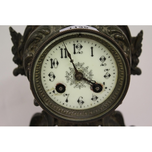 1130 - Late 19th or early 20th Century French patinated spelter two train mantel clock, of rococo design...