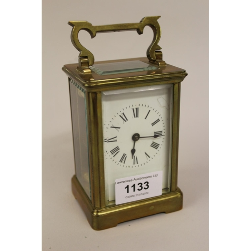 1133 - Gilt brass carriage clock, the enamel dial with Roman numerals (dial at fault)...