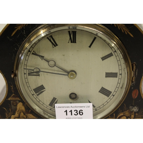 1136 - 1920's Black chinoiserie decorated single train mantel clock with silvered dial...