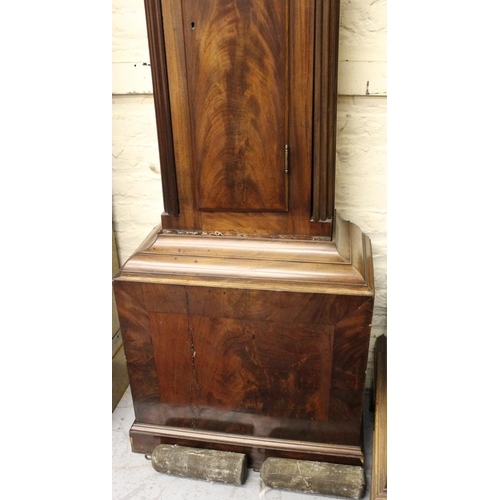 1137 - 19th Century mahogany longcase clock, the arched hood above a Gothic arched panel door on a plinth b...