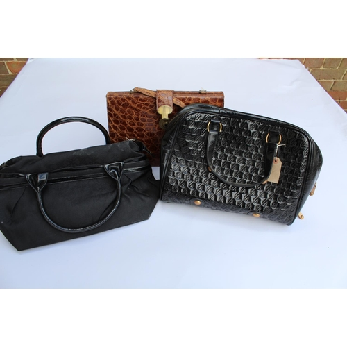 12 - Two Jaeger ladies black patent leather handbags, together with a leather simulated crocodile handbag...