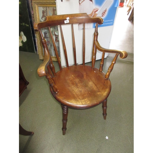 1587 - Early 20th Century beechwood elbow chair with turned rail back above circular panelled seat raised o...