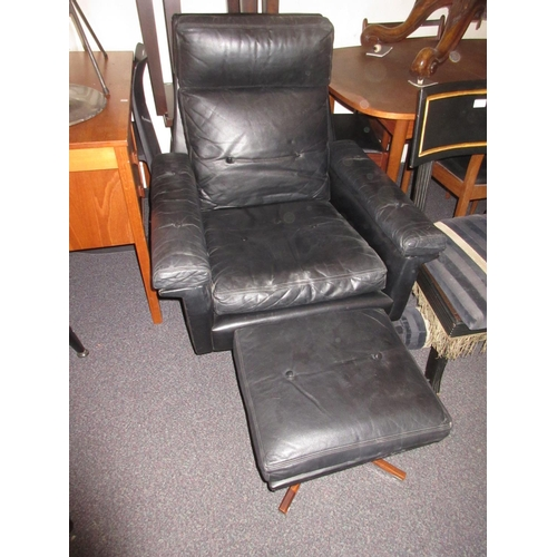 1589 - Soda Galvano, mid 20th Century black button leather upholstered armchair with ottoman stool...