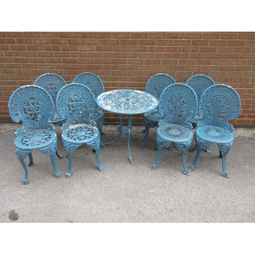 1601 - Two sets of four blue painted cast alloy garden chairs, together with a similar circular garden tabl...