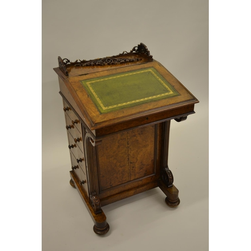 1609 - Victorian figured walnut Davenport with leather inset top above four side drawers raised on low bun ...