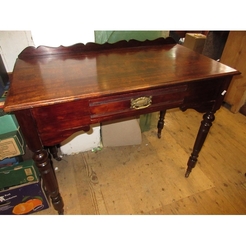 1610 - Late 19th Century mahogany side / hall table with a single frieze drawer raised on turned supports...